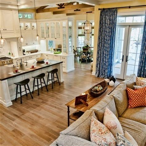 open concept layout love the dining nook would be love this open floor plan white kitchen wood floors