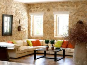 Stone living room wall and rectangular glass top coffee table mesmeriz