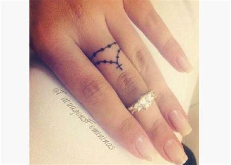 tattoo under finger cross tattoo under ring finger tattoo s imagine cross