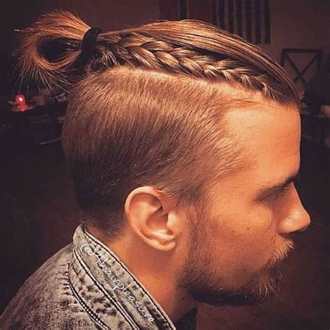 the man bun braids a surprising new men s hair trend
