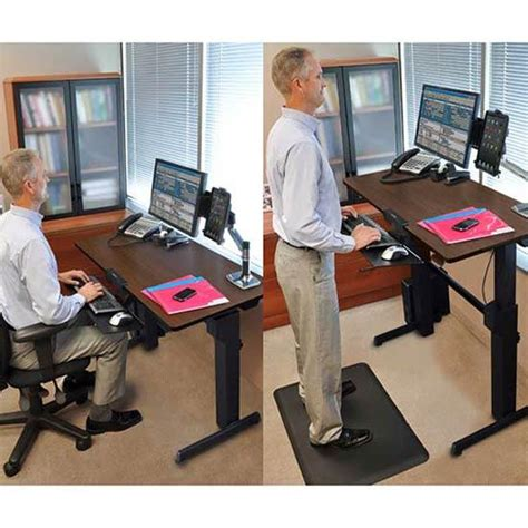 computer desk moves up down amazon com ergotron workfit d sit stand desk walnut