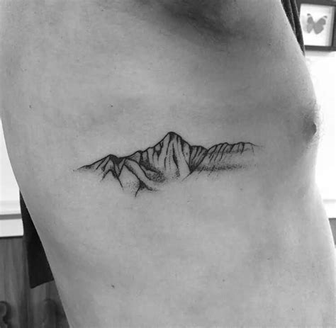 small tattoo price range simple outline mountain on side rib cage