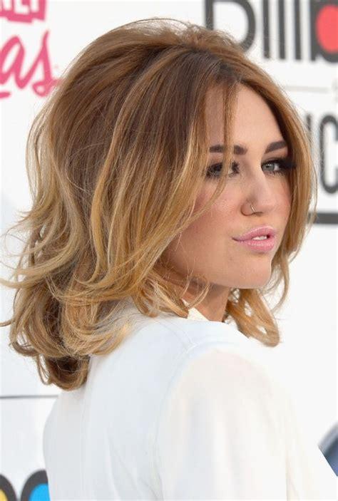 medium length ombre hair color side view of miley cyrus medium ombre hair voluminous bob