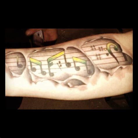 bob marley tattoo with jamaican colors tattoo