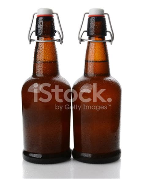 beer bottles swing top swing top beer bottles with condensation stock photos