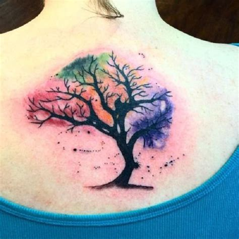watercolor tree of life tattoo on upper back