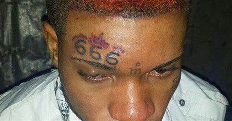 men with 666 on forehead photo man boldly tattoos 666 on his forehead
