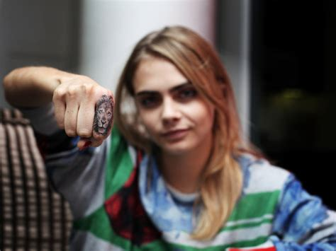 cara delevingne lion tattoo artist talks rihanna cara delevingne and
