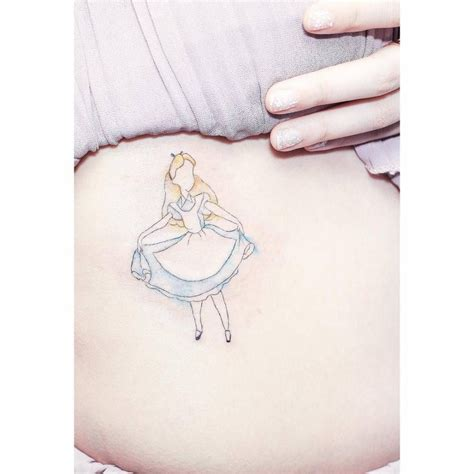 minimalist tattoo with alice in wonderland and disney