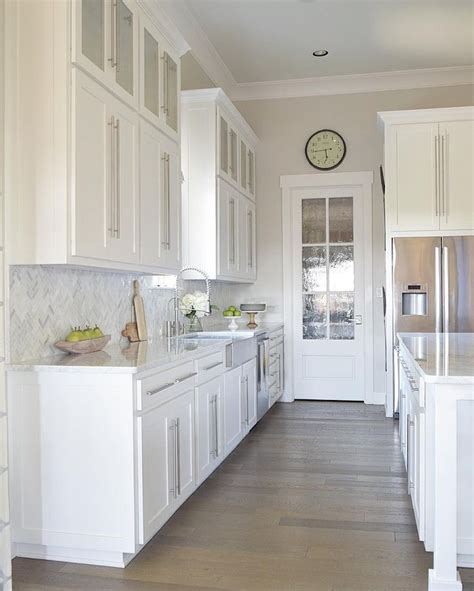 beautiful cabinets and carrara marble on pinterest gorgeous white kitchen with white carrara marble and white
