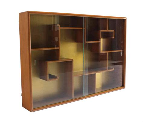 ornate hanging bookcase shelf with glass doors for sale at
