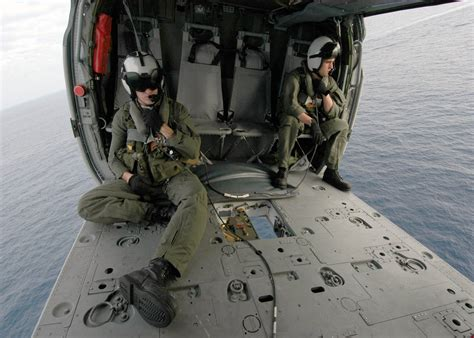 Us Navy Search File Us Navy 040423 N 4190w 001 Search And Rescue Swimmer Sar Members Sit In A Mh