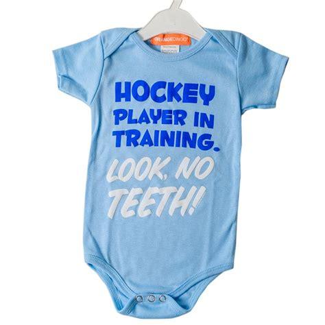 Hockey player in training baby onesie