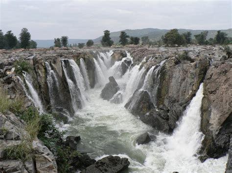toy boat over waterfall tamilnadu tourism hogenakkal falls or hogenakal falls