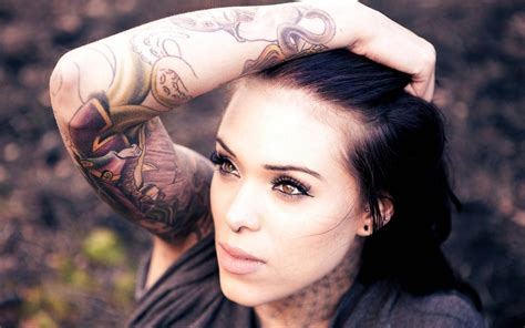girl with tattoo with and piercingshelenasaurus