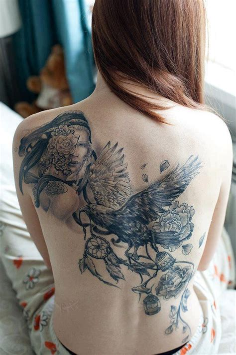 tattoo girl raven dream catcher and flying raven tattoo on back