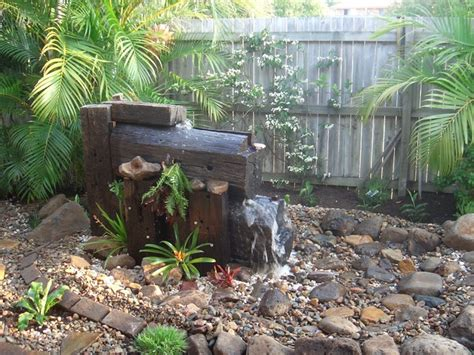 rustic water feature rustic garden sunshine coast by peter smith landscapes
