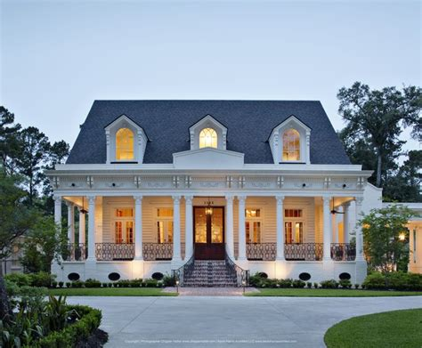 southern architects front door at dusk with cozy porch and white columns on