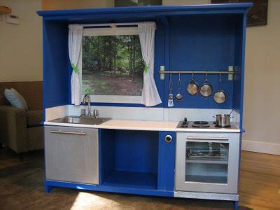 her old tv cabinet was useless until she transformed it purplelicious diy kids play kitchen