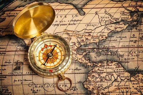 My Home Plans by Old Vintage Golden Compass On Ancient Map Stock Photo