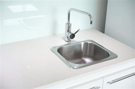Stainless Steel Faucet With White Sink Free Stock Photo 10663 Stainless Steel Sink And Faucet