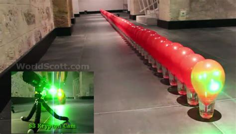 Laser Popping Balloons by Popping 100 Balloons With A Laser Pointer Is Just As Cool
