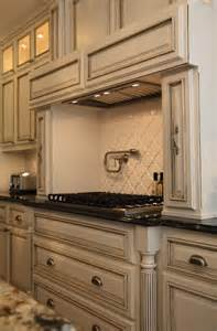 Antique ivory kitchen cabinets with polished granite black countertops