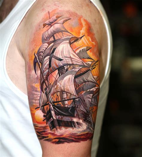 sailing ship with orange sky mens upper arm piece best