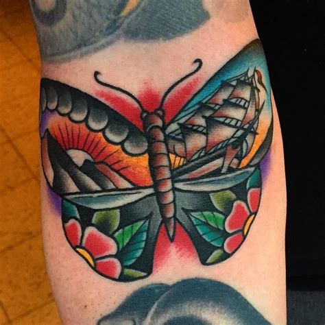 traditional butterfly tattoo traditional butterfly on arm by samuele briganti