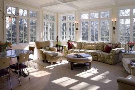 sunroom living room informal dining room and sunroom traditional living room baltimore by melville