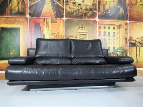 ottoman traduction rolf black leather sofa 2 pieces type 6500