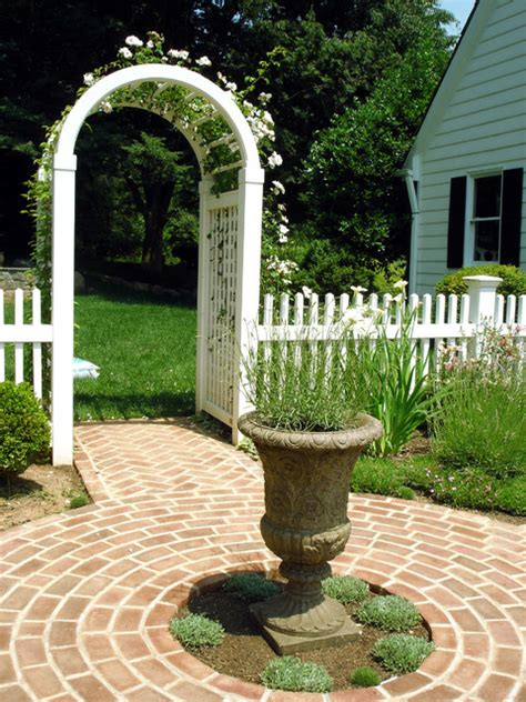 land design landscape architects inc trellis with white picket fence and garden path