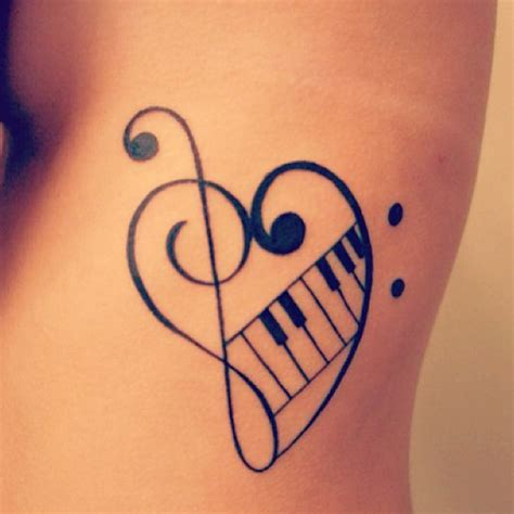 heart with music notes tattoo designs black on finger
