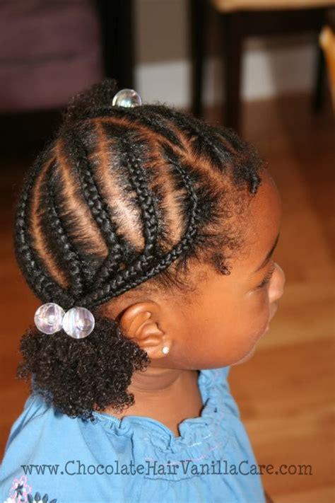 asysmetrical braids cornrows with two asymmetrical puffs chocolate hair