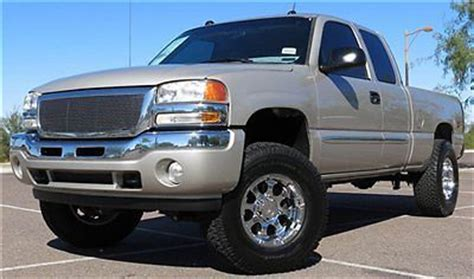find   reserve  gmc sierra lifted  ext quad