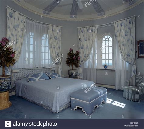 pale blue bedroom blue ottoman below bed with pale blue linen in circular
