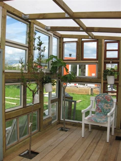 backyard tiny hobby house built  recycled windows
