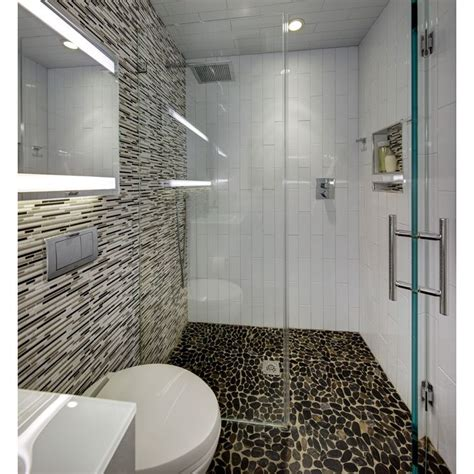 modern small bathroom with river rock floor in curbless