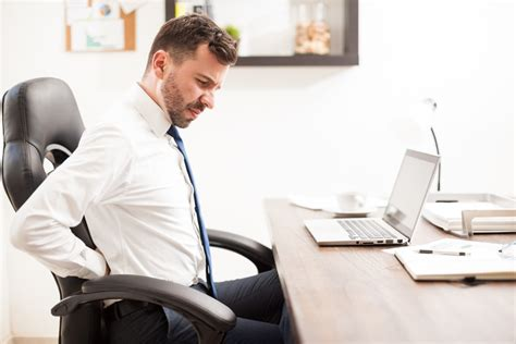 back pain from sitting at desk stand up for your health at your desk job