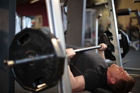 Machine Press Vs Bench Press barbell vs smith machine bench press the pro s con s of each