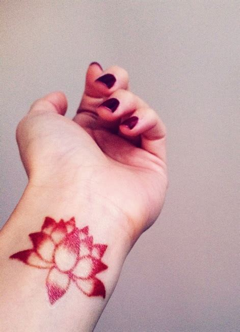 red lotus tattoo lotus flower wrist designs ideas and meaning
