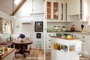 Cabinets with glass doors help make small kitchens look larger in her
