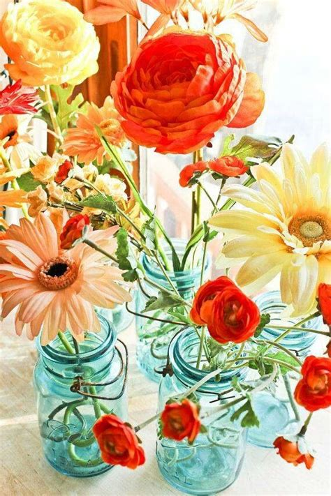 colorful flowers picture orange flowers in bloom light 21 best images about teal blue orange wedding ideas