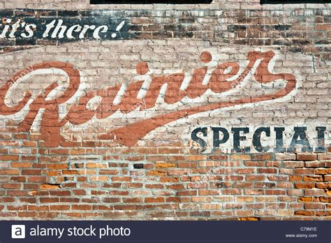 680 best vintage outdoor wall advertising art images faded retro advertisement for rainier ale painted on wall of stock photo royalty free image