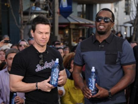 eminem mark wahlberg p diddy donates a million bottles of water to poisoned