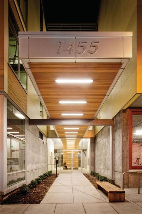 building entrance canopy  linear recessed lighting