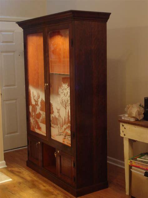 cherry gun cabinet