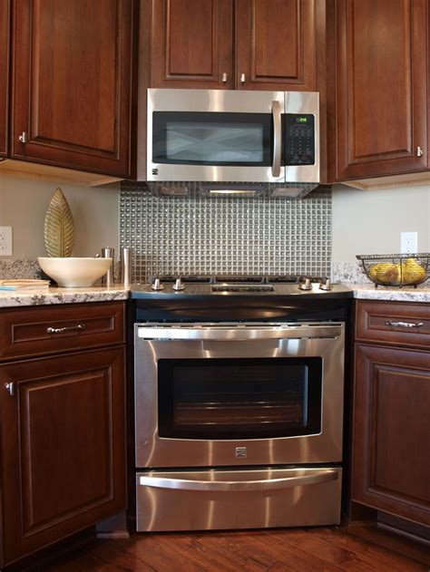 kitchen ideas with stainless steel backsplash smith design granite counters tile backsplash behind slide in range
