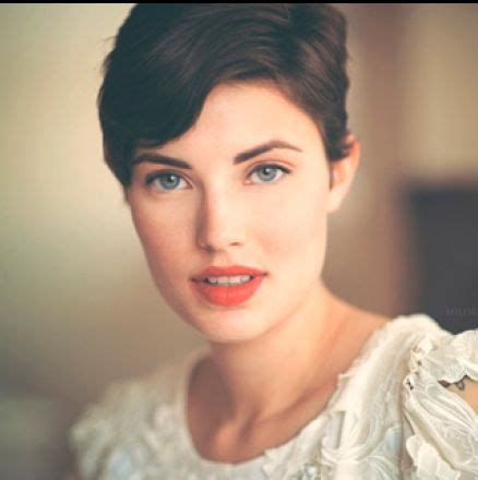 tan skin brown eyes pixie cut hair color short cut with dark brown color for a square jaw with blue