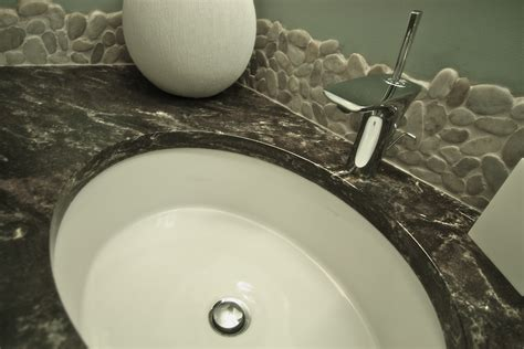 rocks in bathroom river rock backsplash give a new and natural accent to